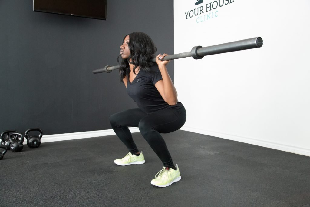 Woman squats with weights