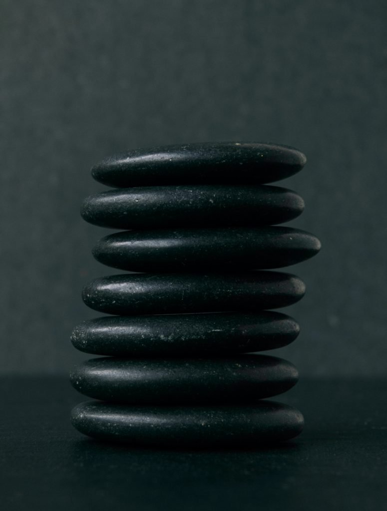 selective focus photography of seven stacked stones