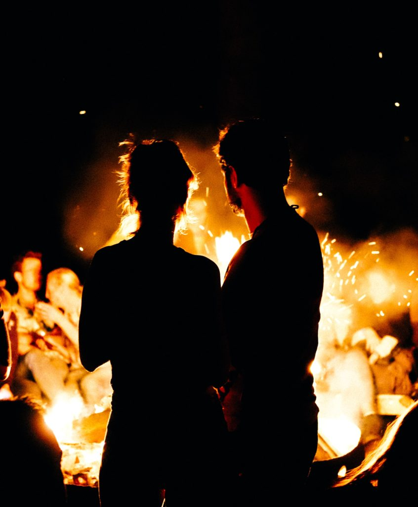 Warmth counteracts Stomach Cold Invasion: two persons standing in front of bonfire