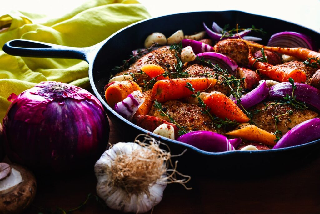 carrots, garlic, onions, and herb spicing meat on skillet: mostly good for Kidney Yang deficiency